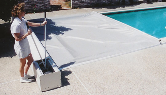 Lady using Manual Pool Cover